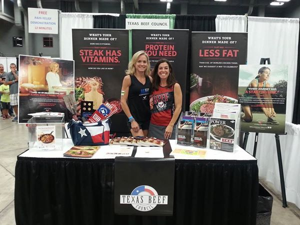 jackie and jen at beef booth naturally fit 2014