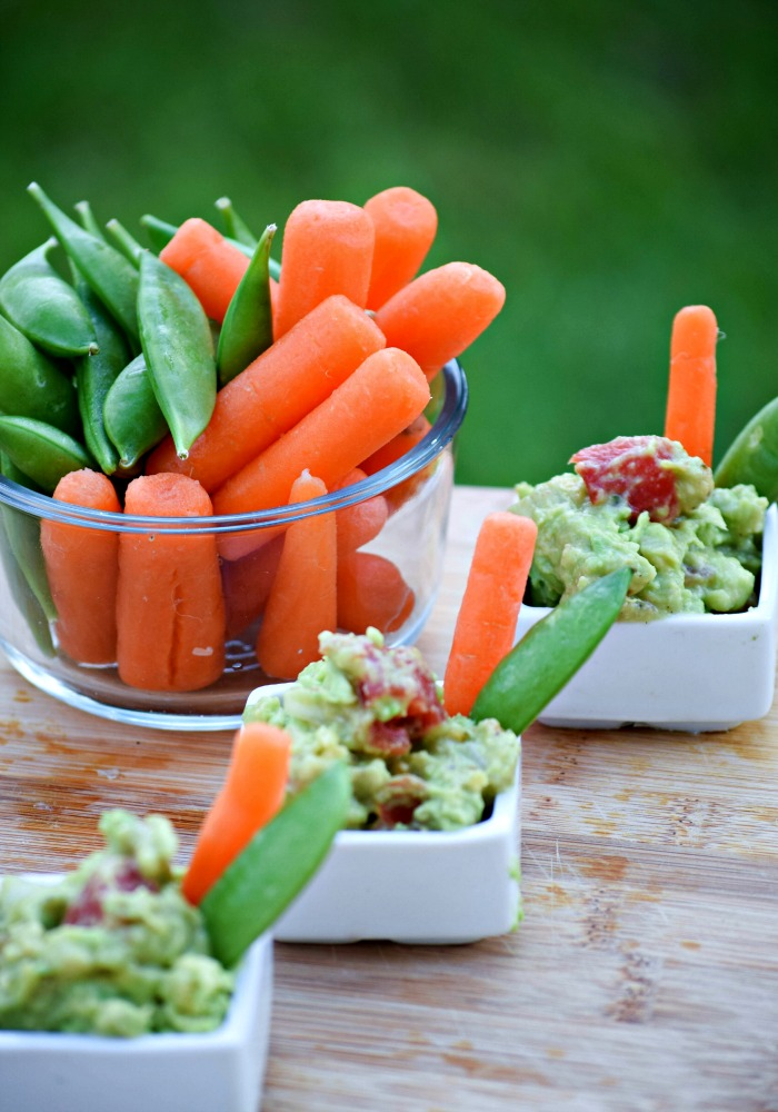 Serve RO*TEL's Rockin' Guac in individual cups with fresh vegetables for a healthy option.