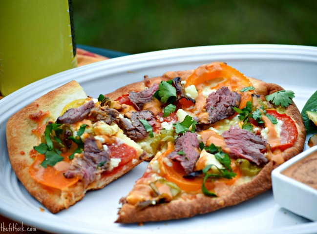 Use leftover beef steak, fresh tomatoes and naan bread to make a easy weeknight meal.
