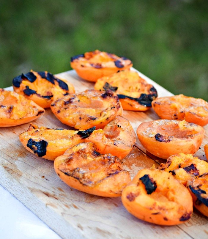 Slice apricots in half, remove pit, brush with olive oil and toss on the grill!