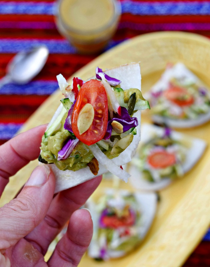 Raw Jicima Nachos make a vegan swap for the traditional recipe.