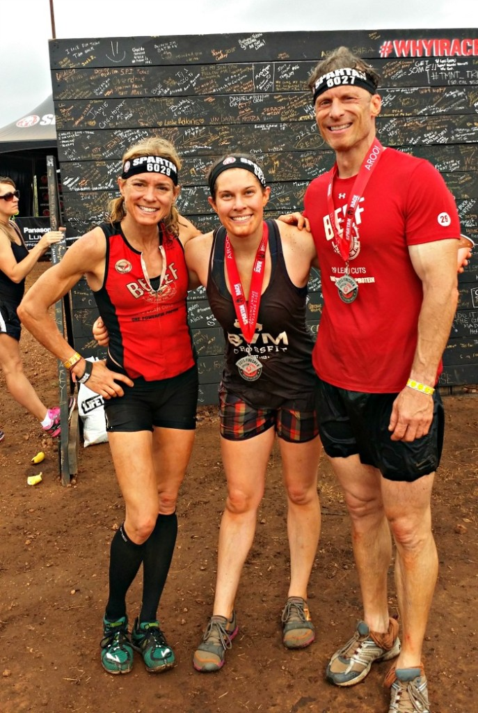 Celebrating with friends at the end of Spartan Race.