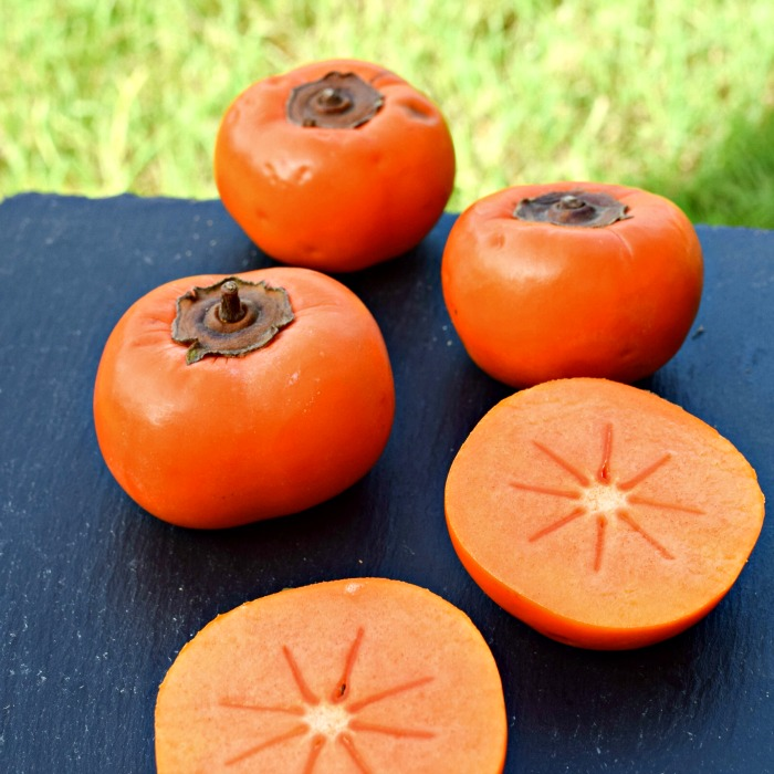 Persimmons look like a tomato, but had a sweet, fruity taste.