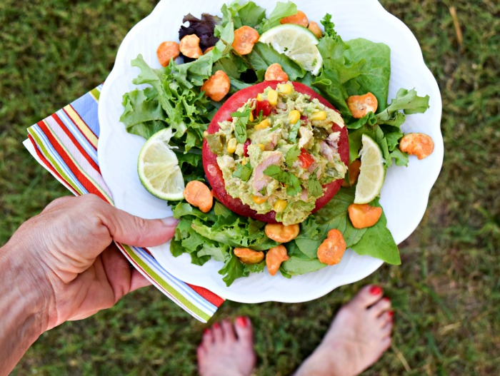 This Southwestern Avocado Tuna Salad in a tomato cup makes a protein-rich, yummy meal that works for low-carb and paleo diets.
