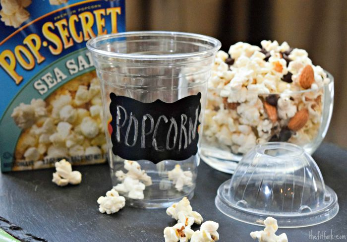 Putting popcorn and custom mix-in ingredients into cups with domed lids is an easy and mess-free way to make and eat!