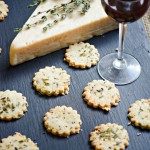 Gluten Free Asiago Almond Crackers are perfectly paired with a glass of wine!