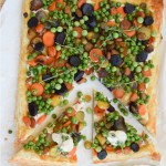 Carrot and Peas Tart is a vibrant addition to your spring brunch, featuring wholesome goodness from the farmer's market.