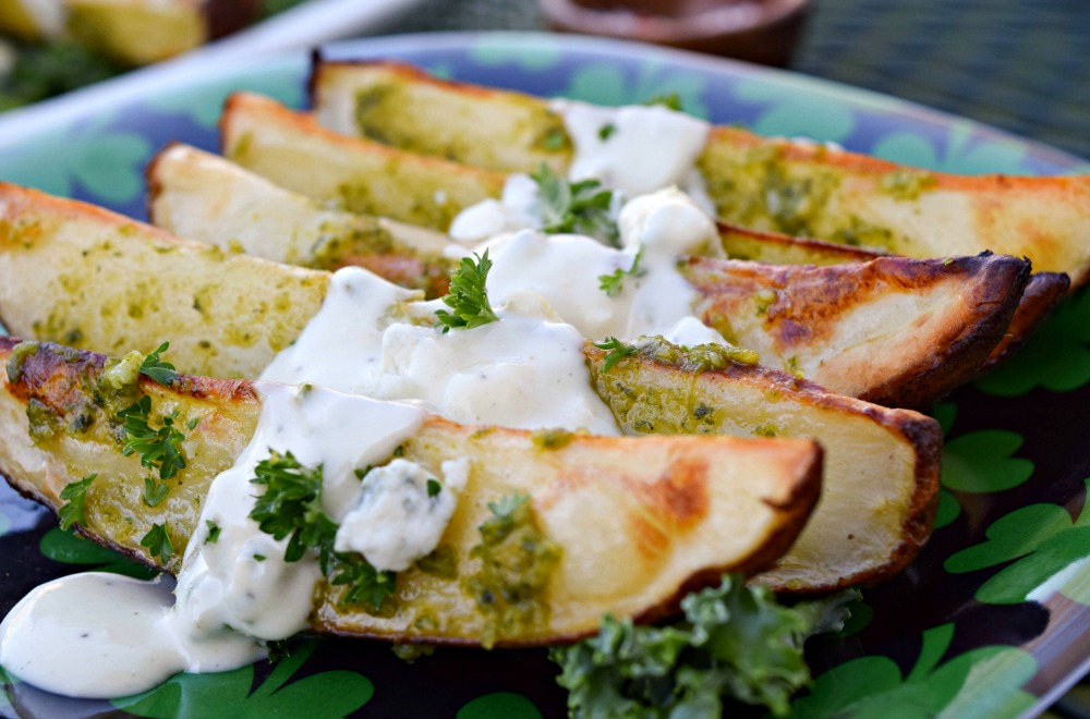 Kale Pesto Oven Fries an be spiralized or cut into wedges for a quick and easy potato side dish. This Irish inspired recipe is fun for St. Patrick's Day.