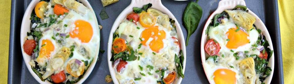 artichoke-spinach-blue-cheese-baked-eggs-three-dishes-baking-sheet-yellow