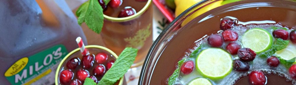Citrus Cranberry Tea with Holiday Ice Ring is a festive addition to your holiday celebration. A non alcoholic libation that's suitable for the entire family. Three ingredient punch an super easy to make ice ring with lemonade, ginger ale, lemons, limes, cranberries and mint.